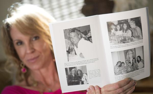 Tanya Brown holds one of her favorite pictures of older sister Nicole Brown Simpson, upper left, taken shortly before her 1994 murder. Her family photos are included in her new book, Finding Peace Amid the Chaos: My Escape from Depression and Suicide. June 12th will be the 20th anniversary of the death of Nicole Brown Simpson and Ron Goldman.    ///ADDITIONAL INFORMATION: OJanniversary.0321.cy     Ð  03/19/14 Ð CINDY YAMANAKA, ORANGE COUNTY REGISTER -  Tanya Brown, the sister of Nicole Brown Simpson, has a new book out about her battle with depression timed to the upcoming 20th anniversary of the murder of her sister and Ronald Goldman. We focus on her book but include in the story other movies/books/projects in the works as the June 13 anniversary approaches.